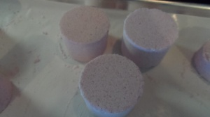 Bath Fizzies:  we used to call these Bath Bombs, but these days that seems politically incorrect.  These are made with Cocoa Butter, baking soda, citric acid and epsom salts.  Fragrance and colors vary.  Some are made with clays, others with powdered goat's milk.